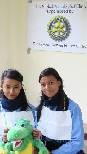Girls in Global Dental Relief clinic, receiving information about dental care